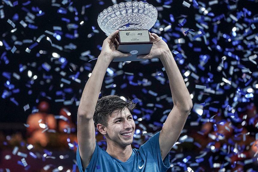 Alexei Popyrin of Australia holds up the trophy after winning his men's singles final match against Alexander Bublik of Kazakhstan at the Singapore Tennis Open ATP 250.