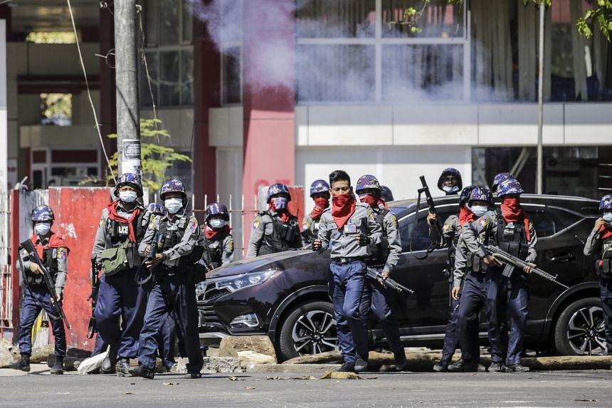 Anti-riot police officers prepare to fire tear gas during protests against the military coup on March 1, 2021.