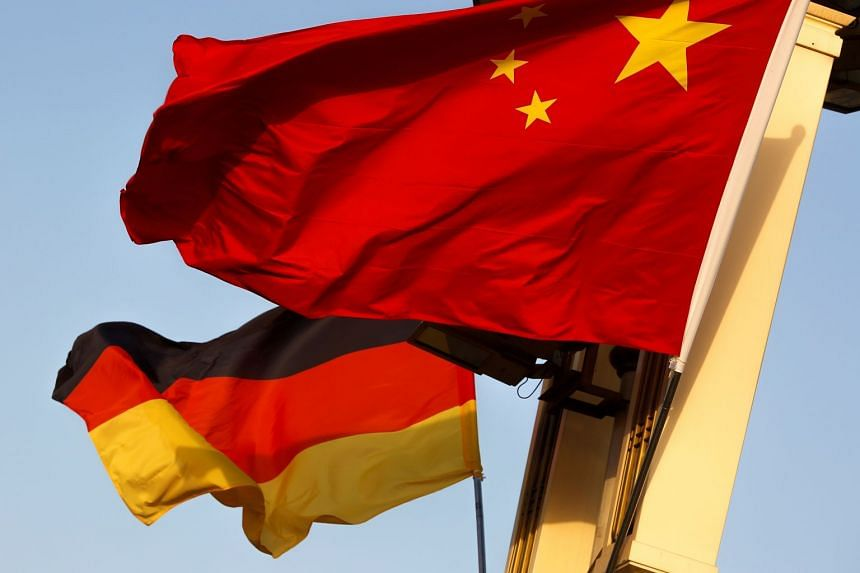 A 2018 photo shows the flags of Germany (left) and China flying in Beijing.