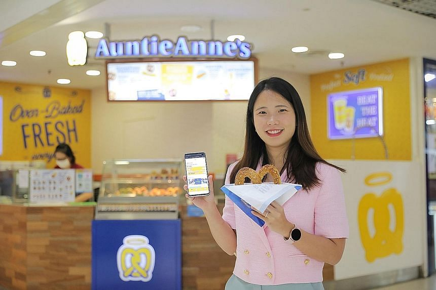 A digital consultant helped Ms Olivia Sulaeman, chief executive of the company running the Auntie Anne's outlets, to identify and implement suitable digital solutions to automate her payroll and claims processing system, among others. ST PHOTO: ONG W