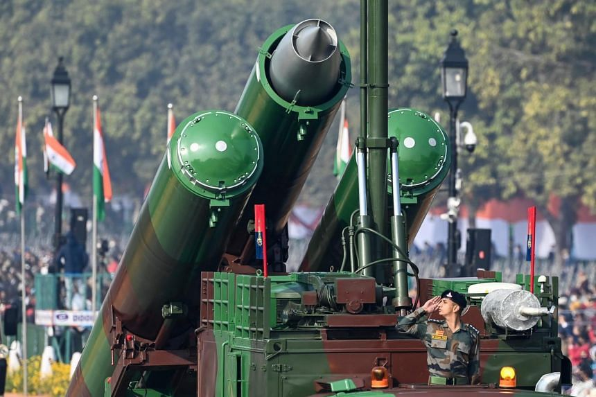 A soldier salutes from a Brahmos Weapon system in New Delhi, on Jan 26, 2021.