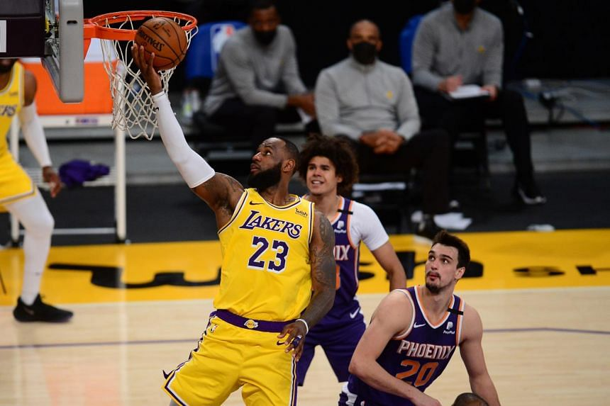 Los Angeles Lakers' LeBron James moves to the basket during a match against the Phoenix Suns at the Staples Centre on March 2, 2021.