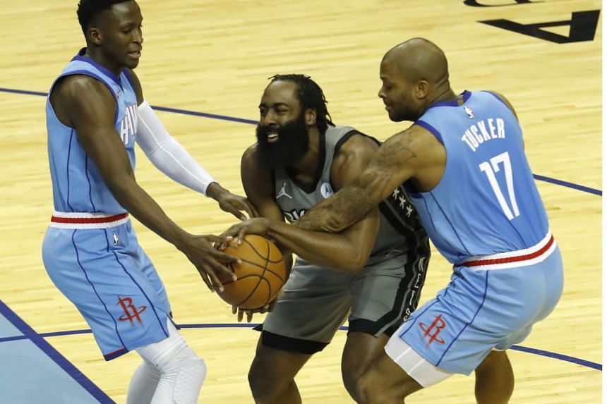 James Harden (centre) of the Brooklyn Nets at Toyota Center in Houston, Texas, on March 3, 2021.