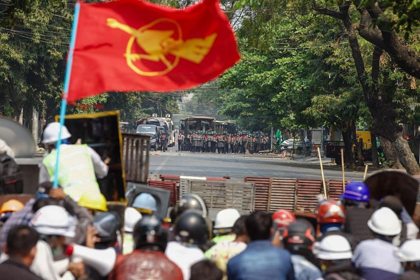 Protesters face off with police during a demonstration against the military coup in Mandalay, Myanmar, on March 3, 2021.