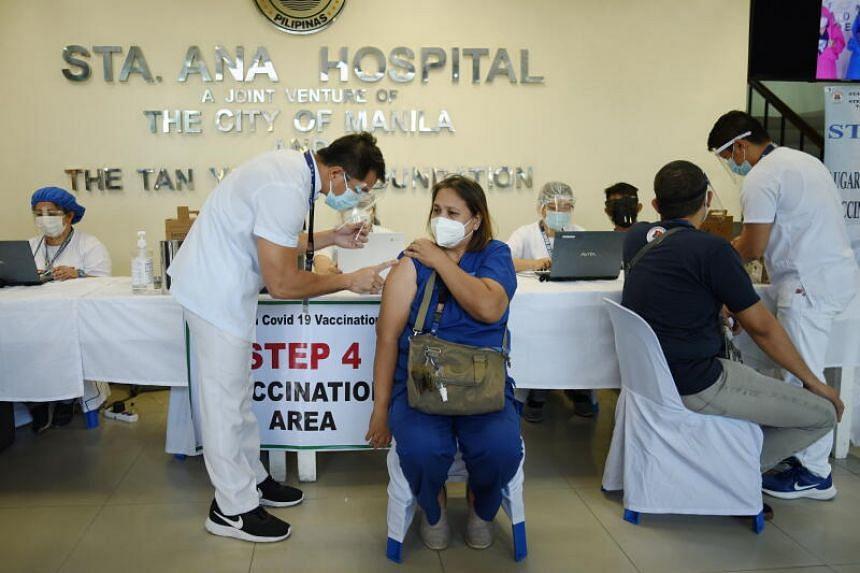 Health workers prepare to inoculate fellow health workers with Sinovac Biotech's Coronavac vaccine for the coronavirus disease, at Sta. Ana Hospital, in Manila, Philippines, on March 2, 2021.