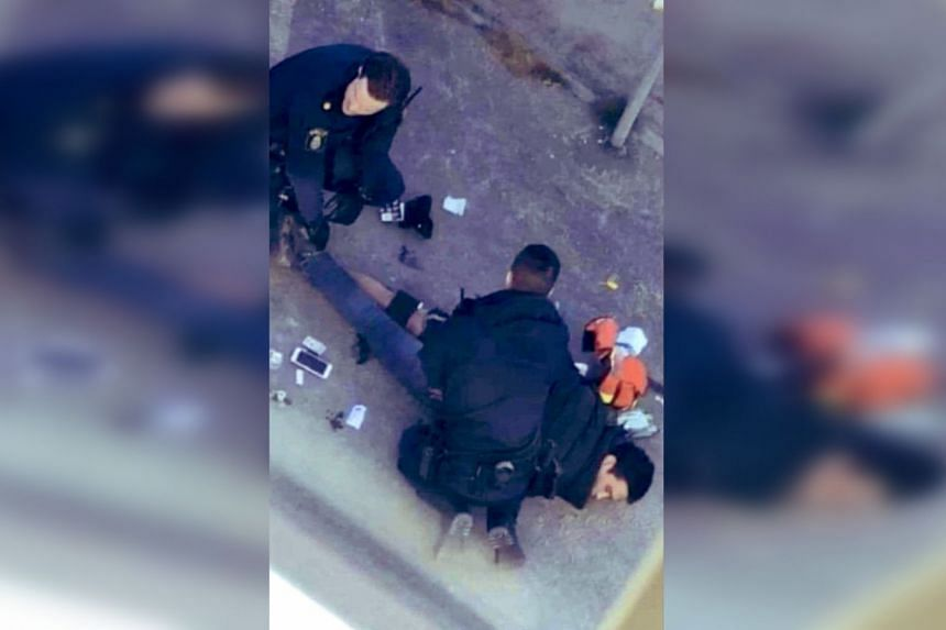 A man in his twenties was taken to hospital after being shot in the leg by police when he was taken into custody,