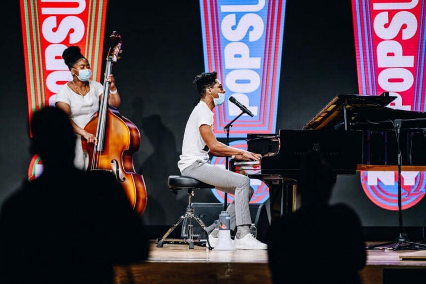 Jon Batiste (centre) and Endea Owens perform at a pop-up concert at the Javits Center in New York, on Feb 20, 2021.