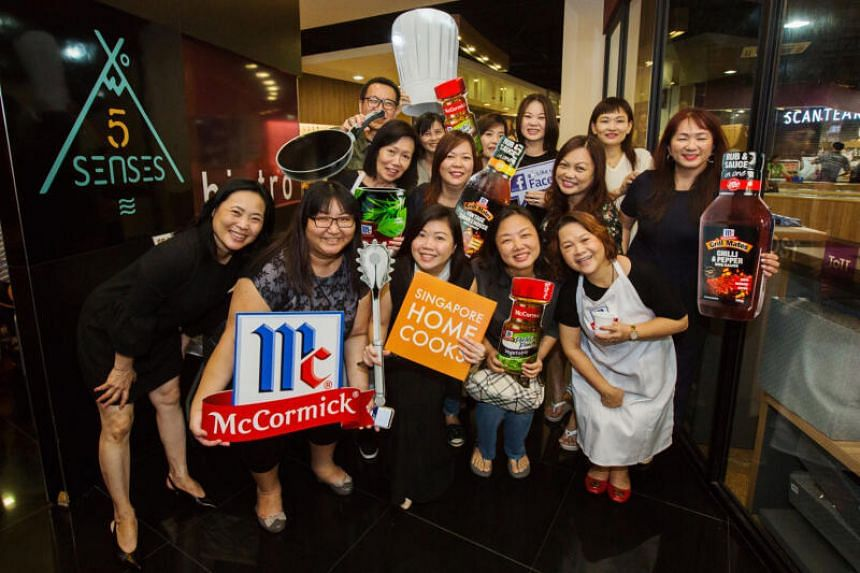 Ms Cassandra Xu (middle, holding Singapore Home Cooks placard) with members of the Singapore Home Cooks Facebook group.