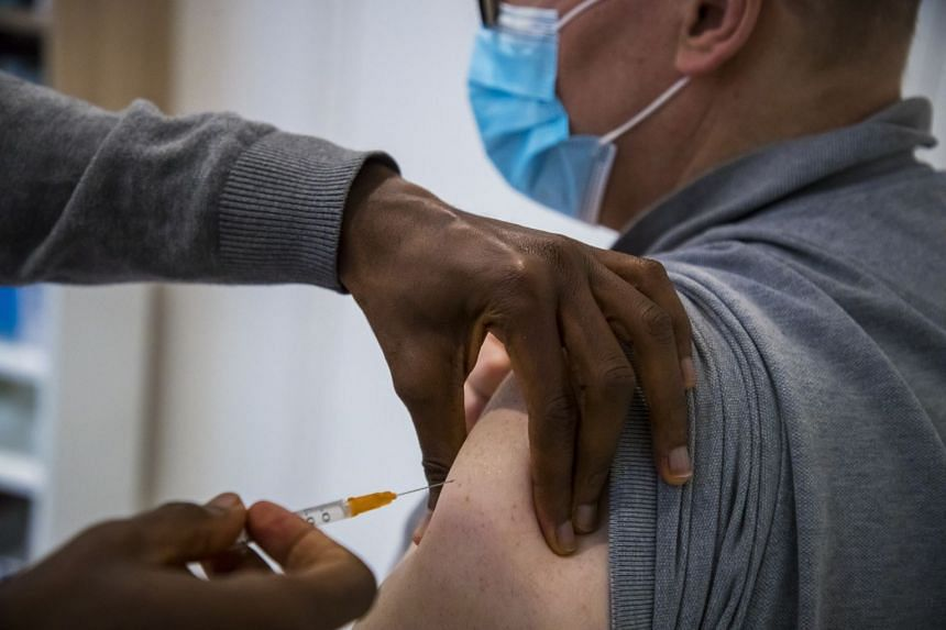 A man receives the Oxford Astra Zeneca vaccine at a private medical office in Paris France
