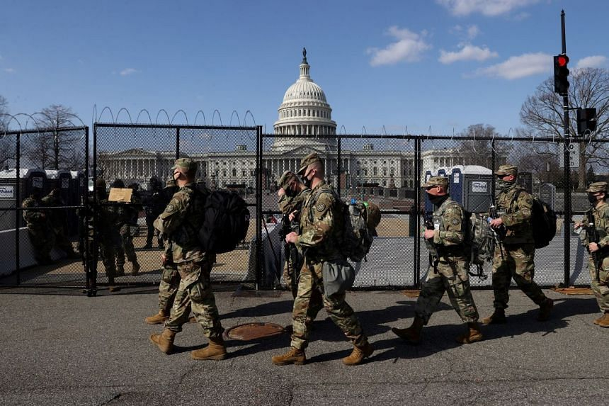 National Guard soldiers patrol the grounds of the US Capitol in Washington on March 4, 2021.