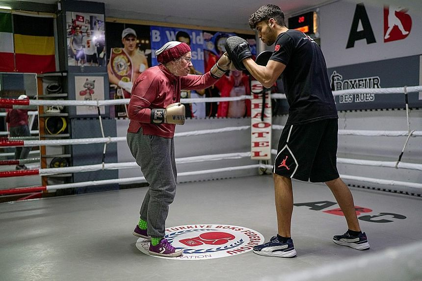 Ms Nancy Van Der Stracten, a 75-year-old who has Parkinson's disease, boxing with her trainer Muhammed Ali Kardas in the ring at a boxing club in Antalya, Turkey, last week. She discovered the benefits of non-contact boxing while researching the dise