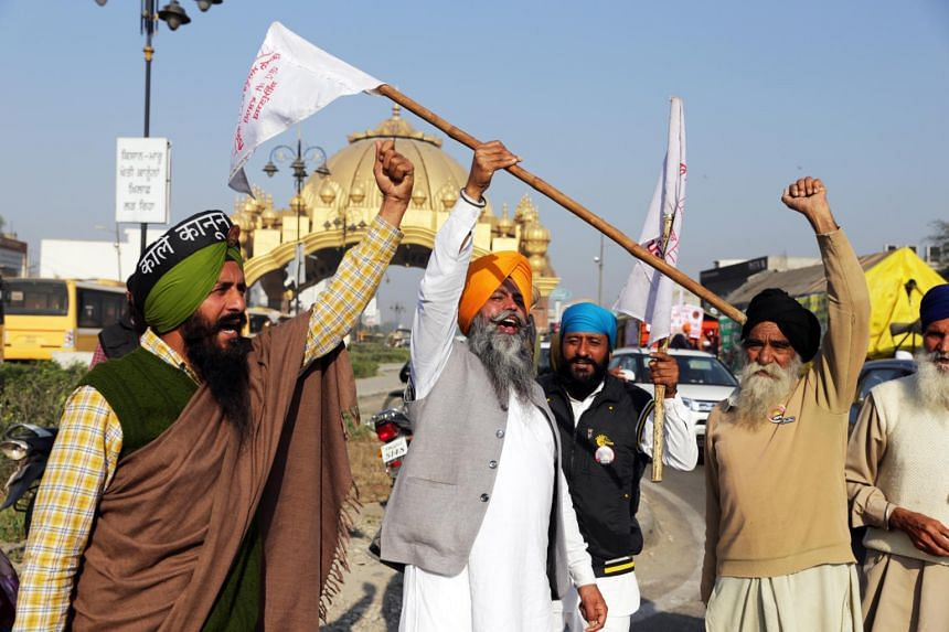 Farmers shout slogans as they prepare to march towards the Delhi border, in Amritsar on March 5, 2021.