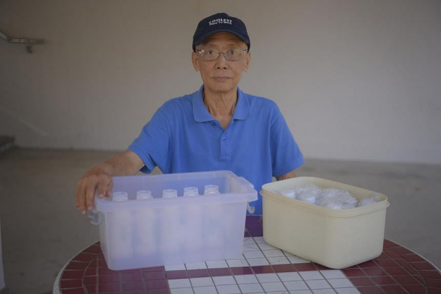 Retiree Lee Meow Khin with his medicine delivered to his home.