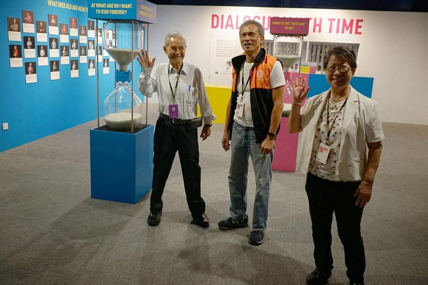 Retiree Mike Goh (centre) said that his work and involvement in various activities has allowed him to meet more people.
