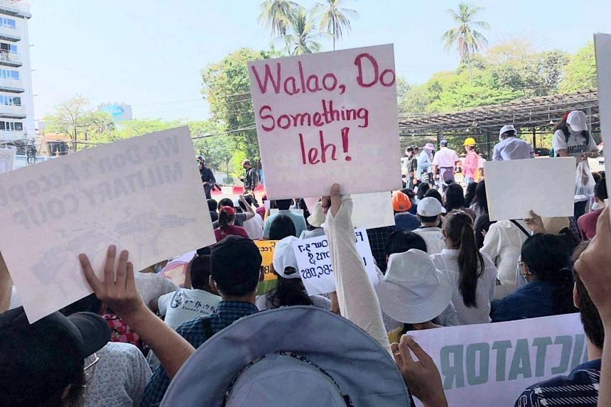 Protesters carrying placards near the Singapore embassy in Yangon.