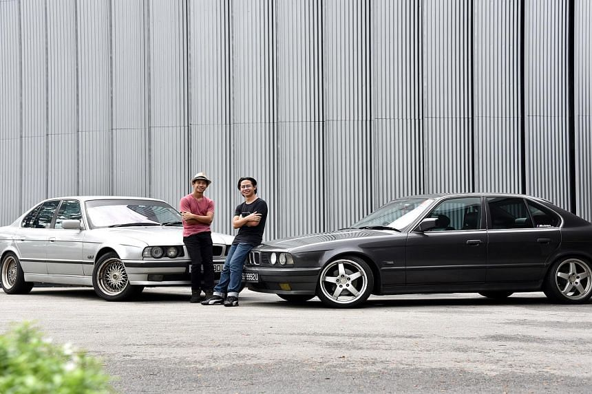 Twin brothers Irshad Noorhalim (left) and Irfan Noorhalim with their cars.
