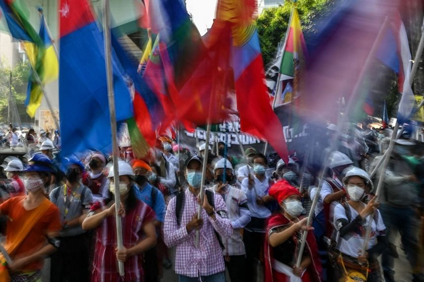 Members of various ethnic groups take part in a demonstration against the military coup in Yangon on Feb 24, 2021.