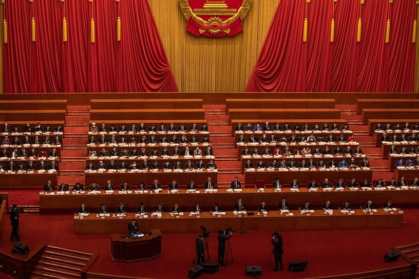 Premier Li Keqiang delivers a speech during the opening session of the National People's Congress (NPC) at the Great Hall of the People, in Beijing on March 5, 2021.