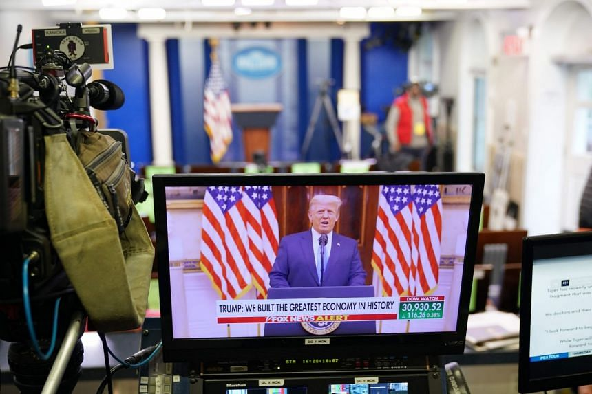 Trump is seen speaking in a video released on YouTube on a monitor at the White House.