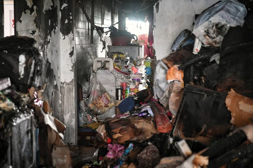 The SCDF said that the fire had engulfed the living room due to the vast accumulation of combustible items within it.