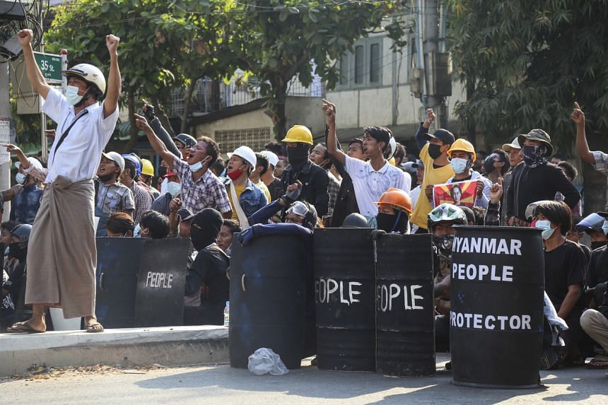 Demonstrators gather on the street during an anti-coup protest in Mandalay, Myanmar, on March 5, 2021.