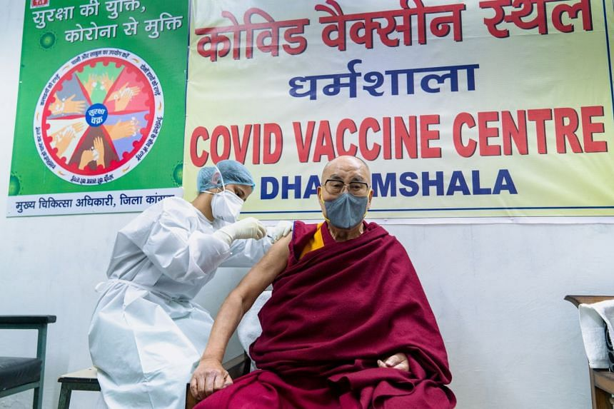 """The Dalai Lama hoped his example (above) would inspire more people to """"have courage"""" to get themselves vaccinated."""