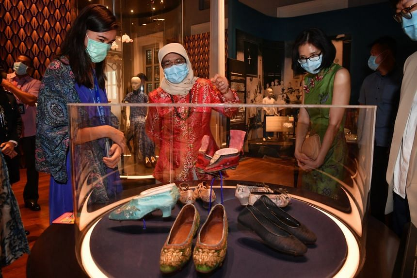 President Halimah Yacob with National Heritage Board CEO Chang Hwee Nee (right) and National Museum assistant curator Miriam Yeo at the museum's Modern Colony gallery.