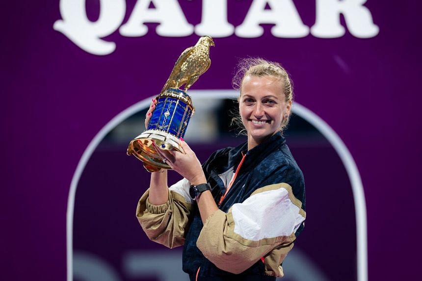 Petra Kvitova celebrates with the trophy after beating Garbine Muguruza of Spain in the Qatar Open final.