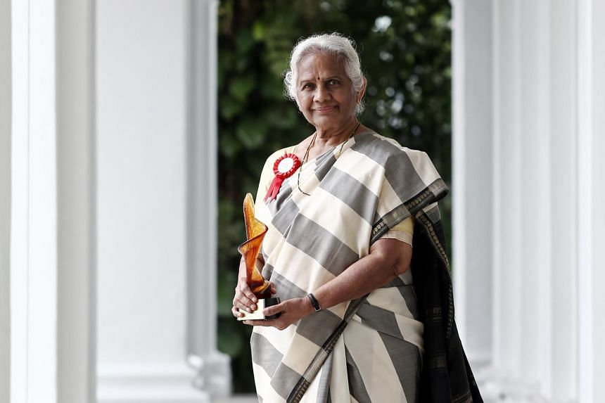 Mrs Santha Bhaskar received the Hall of Fame trophy from President Halimah Yacob at the Istana on March 8.