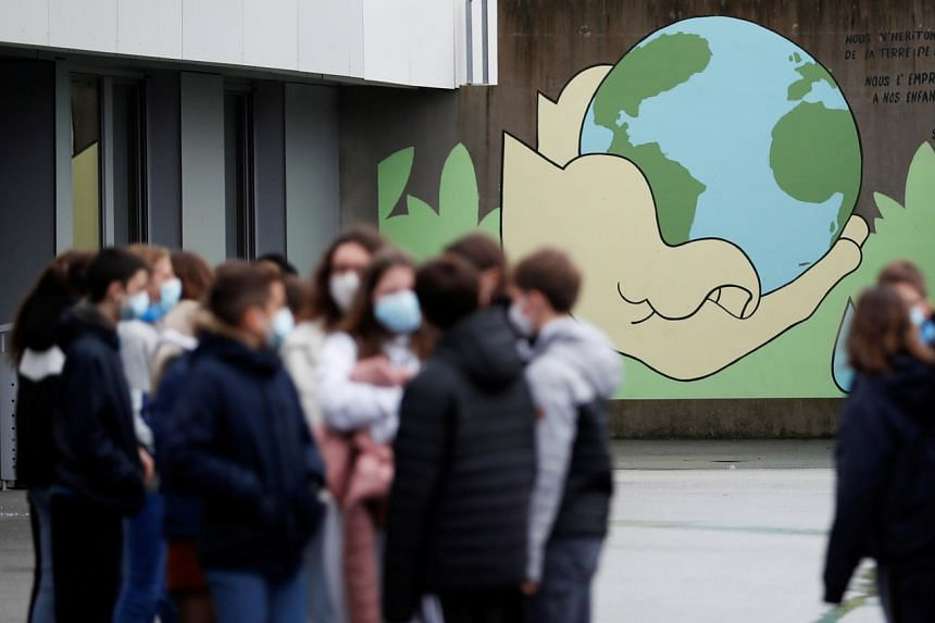 Schoolchildren paying tribute to slain French teacher Samuel Paty at the Anne Franck college in Plescop, France, on Nov 2, 2020.