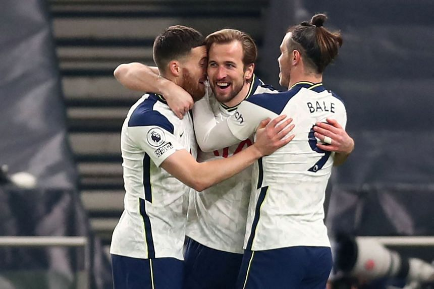 Tottenham Hotspur's Harry Kane (centre) celebrates with teammates after scoring their third goal against Crystal Palace, on March 7, 2021.