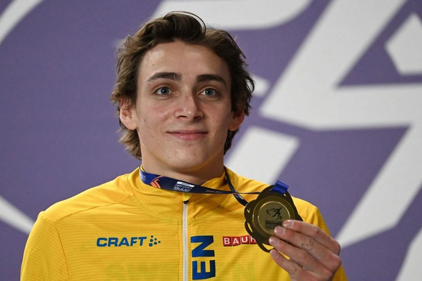 Sweden's Armand Duplantis celebrates his gold medal on the podium at the 2021 European Athletics Indoor Championships in Torun, on March 7, 2021.