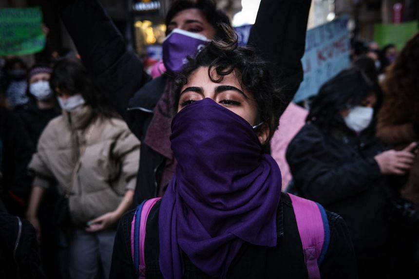 Female protesters shout slogans during a rally marking the International Women's Day in Istanbul, Turkey, on March 8, 2021.
