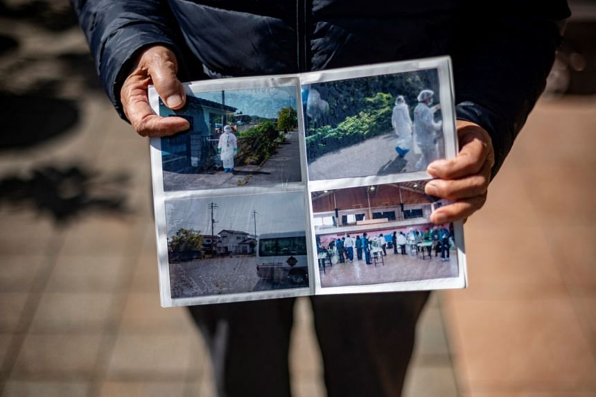 A photo book showing pictures of the evacuation following the Fukushima Daiichi nuclear plant disaster in Fukushima prefecture, on Feb 28, 2021.