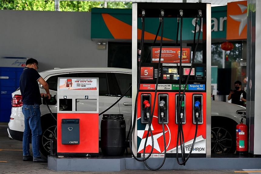 Motorists now have to pay more at the pump, with petrol duties raised last month for the first time in six years. But the Government has cushioned the financial blow with road tax rebates. ST PHOTO: LIM YAOHUI