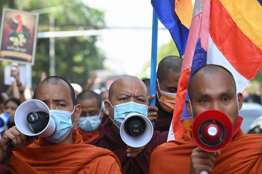 Buddhist monks take part in a demonstration against the Myanmar military coup in Yangon on Feb 24, 2021.