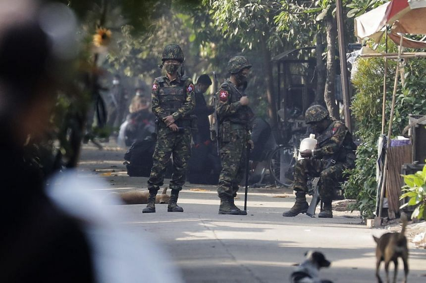 Soldiers are deployed on a street at a railway staff compound during a raid in Yangon, Myanmar, on March 10, 2021.