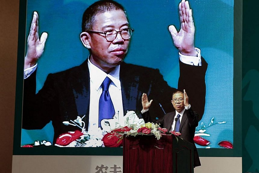 A 2013 photo of Mr Zhong Shanshan, chairman of Nongfu Spring mineral water and a separate pharma company, at a press conference in Beijing. Mr Zhong has achieved one of the fastest accumulations of wealth in history, according to Bloomberg.