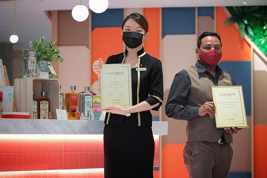 Ms Lim Cheah Yi, a guest services officer at Furama RiverFront, and Mr Mohammad Nurul Amin Mohsinul Azam, a junior supervisor at Conrad Centennial Singapore, received the National Kindness Award - Service Gold at a ceremony at Furama RiverFront yeste