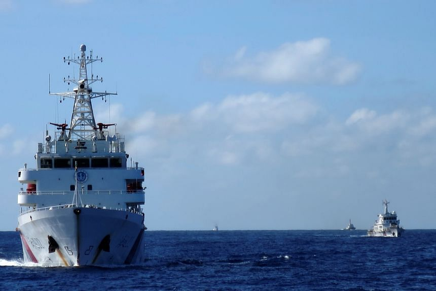 Chinese coastguard ships give chase to Vietnamese coastguard vessels (not pictured) in the South China Sea on July 15, 2014