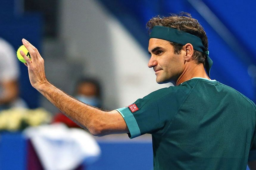 Federer greets the crownd during his round of 16 match against Britain's Dan Evans.