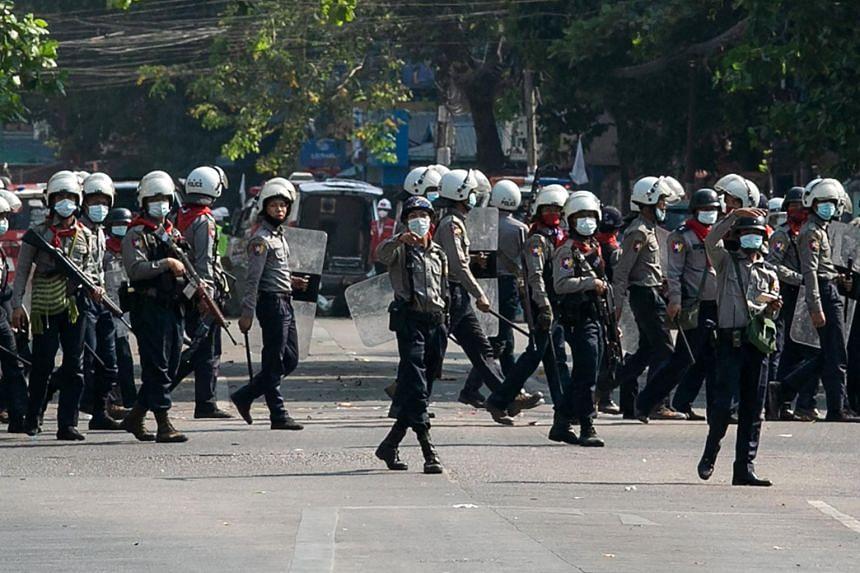 Police keep watch in Yangon on Feb 28, 2021.