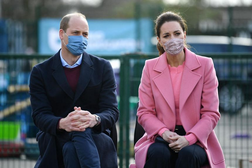 Britain's Prince William with wife Catherine during a visit to a school in east London on March 11, 2021.