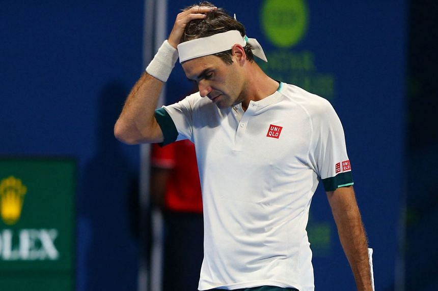 Federer reacts during his match against Nikoloz Basilashvili of Georgia.