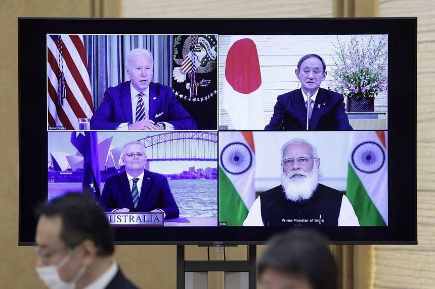 Quad leaders (from top left) Joe Biden Yoshihide Suga, Scott Morrison and Narendra Modi are seen during their virtual meeting.