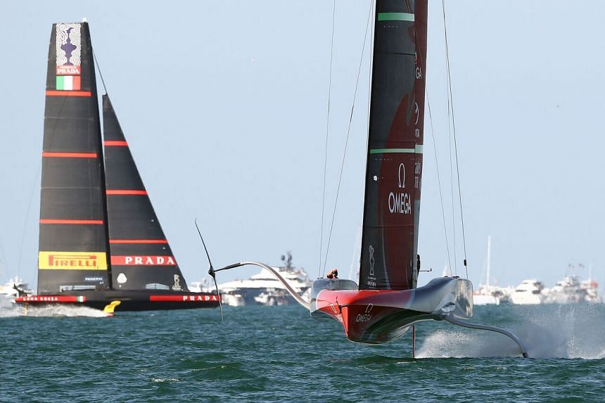 Emirates Team New Zealand (right) competes with Luna Rossa Prada Pirelli during the 36th America's Cup in Auckland, on March 13, 2021.
