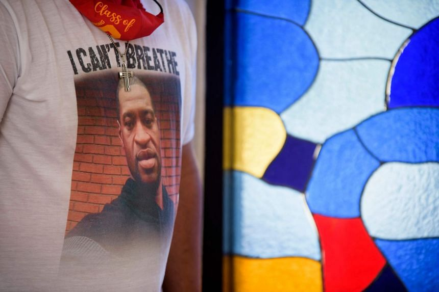 George Floyd is pictured on the T-shirt of a childhood friend at the mausoleum where Floyd is buried in Texas.