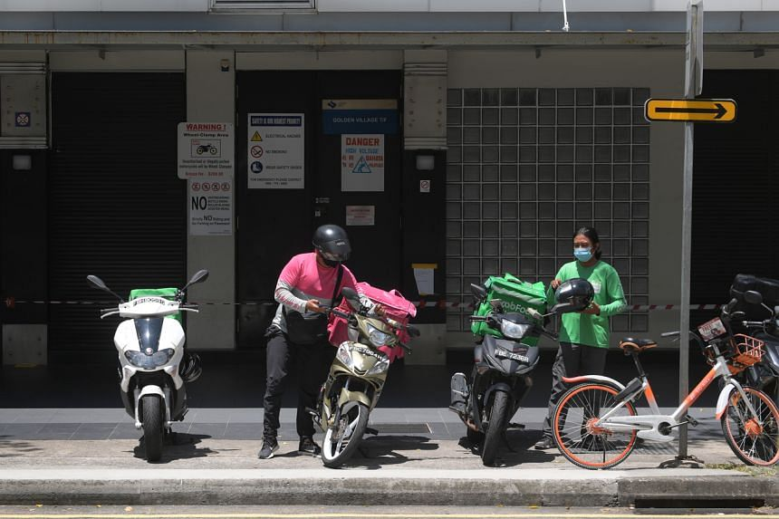 Delivery riders in Yishun on April 20, 2020.