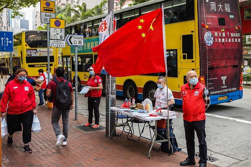 A makeshift stand set up on a busy street in Hong Kong where residents can sign in favour of proposed changes to the local electoral system.