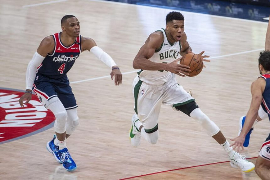 Milwaukee Bucks' Giannis Antetokounmpo (right) in action against Washington Wizards guard Russell Westbrook in Washington on March 13, 2021.